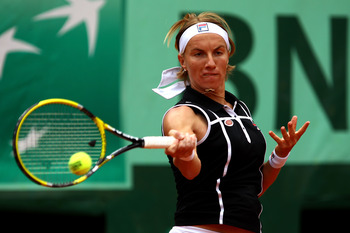 PARIS, FRANCE - MAY 27:  Svetlana Kuznetsova of Russia hits a forehand during the women's singles round three match between Rebecca Marino of Canada and Svetlana Kuznetsova of Russia on day six of the French Open at Roland Garros on May 27, 2011 in Paris,