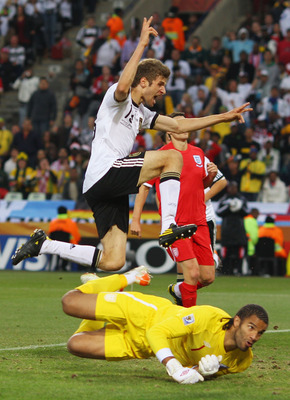 BLOEMFONTEIN, SOUTH AFRICA - JUNE 27:  Thomas Mueller of Germany celebrates scoring his teams fourth past goal David James of England during the 2010 FIFA World Cup South Africa Round of Sixteen match between Germany and England at Free State Stadium on J