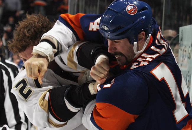 UNIONDALE, NY - DECEMBER 16: Sheldon Brookbank #21 of the Anaheim Ducks and Trevor Gillies #14 of the New York Islanders fight during the first period at the Nassau Coliseum on December 16, 2010 in Uniondale, New York.  (Photo by Bruce Bennett/Getty Image