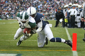 STATE COLLEGE, PA - NOVEMBER 27: Running back Edwin Baker #4 of the Michigan State Spartans runs for a touchdown as safety Malcolm Willis #10 of the Penn State Nittany Lions makes the tackle during a game on November 27, 2010 at Beaver Stadium in State Co