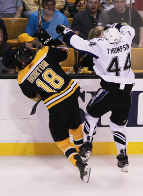 BOSTON, MA - MAY 27: Nathan Horton #18 of the Boston Bruins and Nate Thompson #44 of the Tampa Bay Lightning collide in the first period of Game Seven of the Eastern Conference Finals during the 2011 NHL Stanley Cup Playoffs at TD Garden on May 27, 2011 i