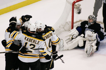 TAMPA, FL - MAY 25:  David Krejci #46 of the Boston Bruins celebrates his third period goal with teammates as Dwayne Roloson #35 of the Tampa Bay Lightning reacts in front of the goal in Game Six of the Eastern Conference Finals during the 2011 NHL Stanle