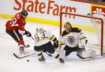 OTTAWA, ON - FEBRUARY 18:  Tuukka Rask #40 of the Boston Bruins kicks out a pad save to teammate Brad Marchand #63 while Jason Spezza #19 of the Ottawa Senators tries to get a stick on the puck during a game at Scotiabank Place on February 18, 2011 in Ott
