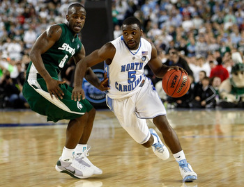 DETROIT - APRIL 06:  Ty Lawson #5 of the North Carolina Tar Heels drives on Travis Walton #5 of the Michigan State Spartans in the second half during the 2009 NCAA Division I Men's Basketball National Championship game at Ford Field on April 6, 2009 in De