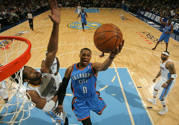 DENVER, CO - APRIL 25:  Russell Westbrook #0 of the Oklahoma City Thunder goes up for a layup as Nene #31 of the Denver Nuggets contests the shot in Game Four of the Western Conference Quarterfinals in the 2011 NBA Playoffs at Pepsi Center on April 25, 20