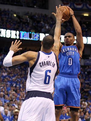 DALLAS, TX - MAY 25:  Russell Westbrook #0 of the Oklahoma City Thunder shoots over Tyson Chandler #6 of the Dallas Mavericks in the fourth quarter in Game Five of the Western Conference Finals during the 2011 NBA Playoffs at American Airlines Center on M