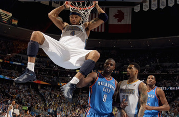 DENVER, CO - APRIL 23:  Kenyon Martin #4 of the Denver Nuggets dunks the ball as Nazr Mohammed #8 of the Oklahoma City Thunder, Wilson Chandler #21 of the Denver Nuggets and Kevin Durant #35 of the Oklahoma City Thunder look on in Game Three of the Wester