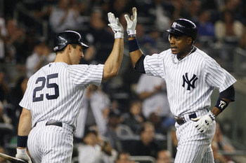 NEW YORK - MAY 21: Curtis Granderson #14 of the New York Yankees is congratulated by teammate Mark Teixeira #25 after hitting a two-run homerun in the bottom of the sixth inning against the New York Mets on May 21, 2011 at Yankee Stadium in the Bronx boro