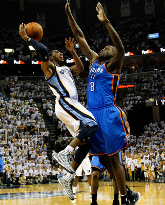 MEMPHIS, TN - MAY 13:  Mike Conley #11 of the Memphis Grizzlies shoots against Nazr Mohammed #8 of the Oklahoma City Thunder in Game Six of the Western Conference Semifinals in the 2011 NBA Playoffs at FedExForum on May 13, 2011 in Memphis, Tennessee.  NO