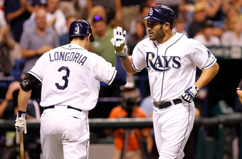 ST. PETERSBURG, FL - MAY 16:  Designated hitter Johnny Damon #22 of the Tampa Bay Rays is congratulated by Evan Longoria #3 after his home run against the New York Yankees during the game at Tropicana Field on May 16, 2011 in St. Petersburg, Florida.  (Ph