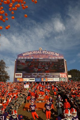 CLEMSON, SC - NOVEMBER 21:  Clemson Tigers players run onto the field with the scoreboard in the background before the game against the Virginia Cavaliers at Memorial Stadium on November 21, 2009 in Clemson, South Carolina. (Photo by Streeter Lecka/Getty