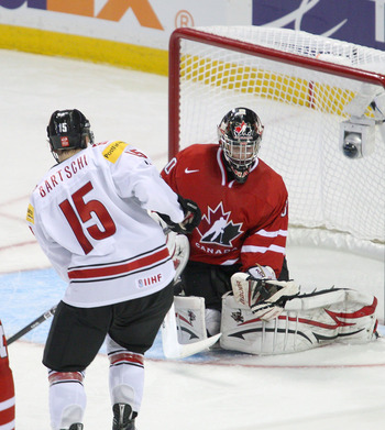 BUFFALO, NY - JANUARY 02: Mark Visentin #30 of Canada makes a save on Sven Bartschi #15 of Switzerland during the 2011 IIHF World U20 Championship game between Canada and Switzerland on January 2, 2011 in Buffalo, New York. Canada won 4-1. (Photo by Rick