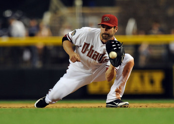 PHOENIX - MAY 20:  Kelly Johnson #2 of the Arizona Diamondbacks makes a play on a ground ball against the Minnesota Twins at Chase Field on May 20, 2011 in Phoenix, Arizona.  (Photo by Norm Hall/Getty Images)