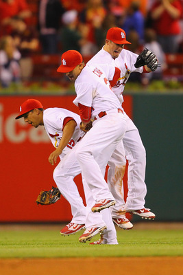 ST. LOUIS, MO - MAY 18: Jon Jay #15, Allen Craig #21 and Tyler Greene #27 all of the St.Louis Cardinals celebrate a victory over the Houston Astros at Busch Stadium on May 18, 2011 in St. Louis, Missouri.  (Photo by Dilip Vishwanat/Getty Images)