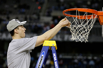 DETROIT - APRIL 06:  Tyler Hansbrough #50 of the North Carolina Tar Heels cuts down a piece of the net after their 89-72 win against the Michigan State Spartans during the 2009 NCAA Division I Men's Basketball National Championship game at Ford Field on A