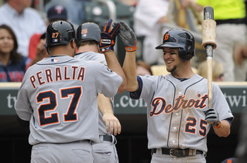 MINNEAPOLIS, MN - MAY 11: Jhonny Peralta #27 and Ryan Raburn #25 of the Detroit Tigers celebrate a two-run home run by Peralta against the Minnesota Twins during in the eighth inning of their game on May 11, 2011 at Target Field in Minneapolis, Minnesota.