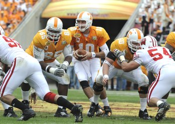 TAMPA, FL -  JANUARY 1: Quaarterback Erik Ainge #10 of the Tennessee Volunteers takes a snap against the Wisconsin Badgers in the 2008 Outback Bowl at Raymond James Stadium on January 1, 2008 in Tampa, Florida.   The Volunteers won 21 - 17. (Photo by Al M