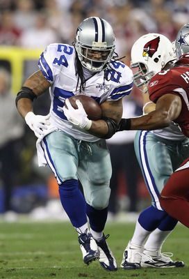 GLENDALE, AZ - DECEMBER 25:  Runningback Marion Barber #24 of the Dallas Cowboys rushes the football during the NFL game against the Arizona Cardinals at the University of Phoenix Stadium on December 25, 2010 in Glendale, Arizona.  The Cardinals defeated