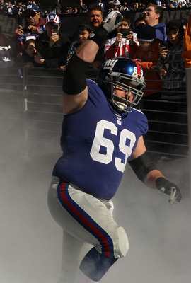EAST RUTHERFORD, NJ - NOVEMBER 28:  Rich Seubert #69 of the New York Giants is introduced before the game against the Jacksonville Jaguars  on November 28, 2010 at The New Meadowlands Stadium in East Rutherford, New Jersey.  (Photo by Al Bello/Getty Image