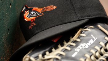 ARLINGTON, TX - APRIL 08:  Detail view of a hat and glove of the Baltimore Orioles resting in the dugout during the game against the Texas Rangers on April 8, 2008 at Rangers Ballpark in Arlington, Texas. The Orioles defeated the Rangers 8-1.  (Photo by C