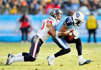 NASHVILLE, TN - DECEMBER 19:  Nate Washington #85 of the Tennessee Titans makes a catch under pressure from Glover Quin #29 of the Houston Texans at LP Field on December 19, 2010 in Nashville, Tennessee. The Titans defeated the Texans, 31-17.  (Photo by G