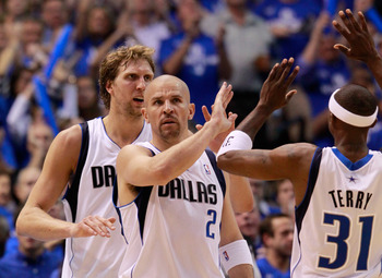 DALLAS, TX - MAY 17:  Jason Kidd #2 of the Dallas Mavericks reacts with teammates Dirk Nowitzki #41 and Jason Terry #31 in the first half while taking on the Oklahoma City Thunder in Game One of the Western Conference Finals during the 2011 NBA Playoffs a