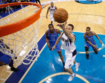 DALLAS, TX - MAY 25:  Jose Juan Barea #11 of the Dallas Mavericks goes up for a shot in front of Eric Maynor #6 of the Oklahoma City Thunder in Game Five of the Western Conference Finals during the 2011 NBA Playoffs at American Airlines Center on May 25,