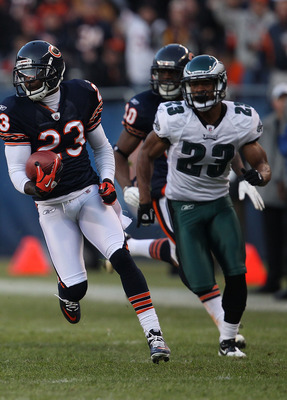 CHICAGO - NOVEMBER 28: Devin Hester #23 of the Chicago Bears breaks for a first down run of 39 yards after a catch pursued by Dimitri Patterson #23 of the Philadelphia Eagles at Soldier Field on November 28, 2010 in Chicago, Illinois. The Bears defeated t