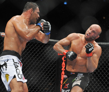 Antonio Nogueira (left) squares off against Randy Couture (right) at UFC 102.