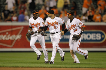 BALTIMORE, MD - MAY 25: Outfielders Felix Pie #18, Nick Markakis #21, and Adam Jones #10 of the Baltimore Orioles run in after the Orioles defeated the Kansas City Royals at Oriole Park at Camden Yards on May 25, 2011 in Baltimore, Maryland.  (Photo by Ro