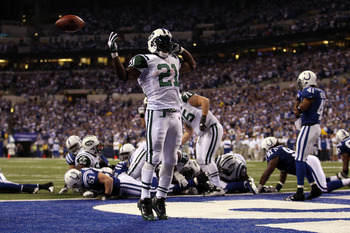 INDIANAPOLIS, IN - JANUARY 08:  LaDainian Tomlinson #21 of the New York Jets celebrates after he scored a 1-yard rushing touchdown in the fourth quarter against the Indianapolis Colts during their 2011 AFC wild card playoff game at Lucas Oil Stadium on Ja