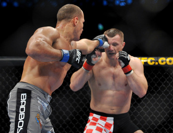 dos Santos (left) goes to strike Mirko Cro Cop (right) at UFC 103.