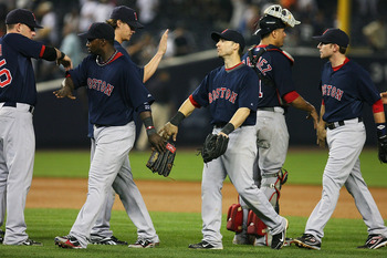 NEW YORK - SEPTEMBER 24:  The Boston Red Sox celebrate after defeating the New York Yankees 10 - 8 on September 24, 2010 at Yankee Stadium in the Bronx borough of New York City.  (Photo by Andrew Burton/Getty Images)