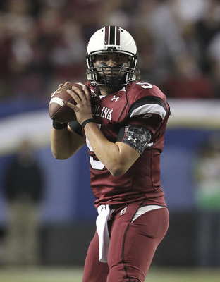 ATLANTA - DECEMBER 4:  Quarterback Stephen Garcia #5 of the South Carolina Gamecocks drops back to pass during the 2010 SEC Championship against the Auburn Tigers at Georgia Dome on December 4, 2010 in Atlanta, Georgia. (Photo by Mike Zarrilli/Getty Image