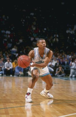1990:  Guard Tyrone (Muggsy) Bogues of the Charlotte Hornets in action with the ball during a game at the Charlotte Coliseum in Charlotte, North Carolina. Mandatory Credit: Stephen Dunn  /Allsport