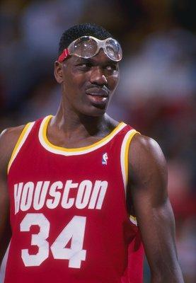 Center Hakeem Olajuwon of the Houston Rockets looks on.