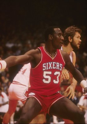 Darryl Dawkins of the Philadelphia 76ers looks on during a game.