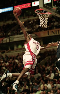 7 Dec 1999:  Gilbert Arenas #0 of the Arizona Wildcats makes a slam dunk during a game against the Connecticut Huskies  at the United Center in Chicago, Illinois. The Huskies defeated the Wildcats 78-69. Mandatory Credit: Kathleen Economou  /Allsport