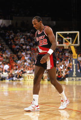 LOS ANGELES - 1990:  Clyde Drexler #22 of the Portland Trail Blazers walks during the 1989-1990 NBA season game against the Los Angeles Lakers at the Great Western Forum in Los Angeles, California.  (Photo by Ken Levine/Getty Images)