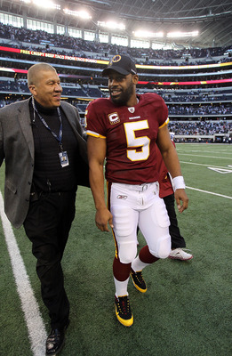 ARLINGTON, TX - DECEMBER 19:  Quarterback Donovan McNabb #5 of the Washington Redskins walks off the field after a loss against the Dallas Cowboys at Cowboys Stadium on December 19, 2010 in Arlington, Texas.  (Photo by Ronald Martinez/Getty Images)