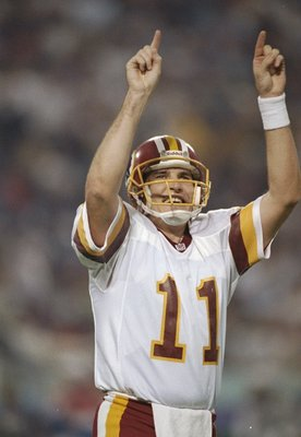 26 Jan 1992:  Quarterback Mark Rypien of the Washington Redskins celebrates during Super Bowl XXVI against the Buffalo Bills at the Hubert H. Humphrey Metrodome in Minneapolis, Minnesota.  The Reskins won the game, 37-24.  Rypien was named the game''s MVP
