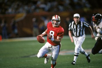 MIAMI - JANUARY 29:  Quarterback Steve Young #8 of the San Francisco 49ers finds room to run with the ball during Super Bowl XXIX against the San Diego Chargers at Joe Robbie Stadium on January 29, 1995 in Miami, Florida. The 49ers won 49-26. (Photo by Ge