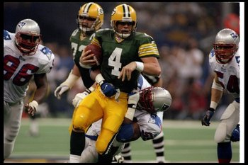 26 Jan 1997:  Quarterback Brett Favre of the Green Bay Packers gets sacked by New England Patriots defensive lineman Mike Jones during Super Bowl XXXI at the Superdome in New Orleans, Louisiana.  The Packers won the game, 35-21. Mandatory Credit: Rick Ste