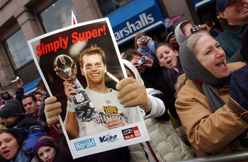BOSTON, MA - FEBRUARY 3:  A New England Patriots fan holds a poster of quarterback and Super Bowl MVP Tom Brady during a victory parade February 3, 2004 in Boston, Massachusetts. The Patriots celebrated their second championship in three years today with