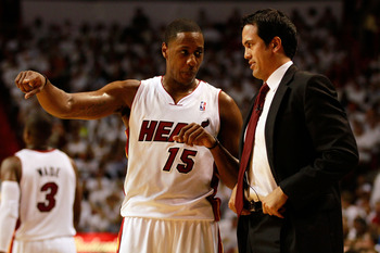 MIAMI, FL - MAY 24:  Head coach Erik Spoelstra of the Miami Heat talks with Mario Chalmers #15 against the Chicago Bulls in Game Four of the Eastern Conference Finals during the 2011 NBA Playoffs on May 24, 2011 at American Airlines Arena in Miami, Florid