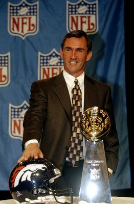 1 Feb 1999:  Head Coach Mike Shanahan of the Denver Broncos stands behind the Vince Lombardi Trophy smilling at the press during the MVP Press Conference after the Super Bowl XXXIII Game Between the Denver Broncos and the Atlanta Falcons at the Pro Player