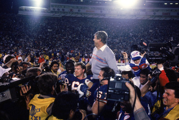 PASADENA, CA - JANUARY 25:  Head coach Bill Parcells of the New York Giants gets carried off the field following the game against the Denver Broncos during Super Bowl XXI at the Rose Bowl on January 25, 1987 in Pasadena, California. The Giants defeated th