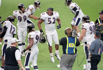 28 Jan 2001:  Ray Lewis #52 of the Baltimore Ravens hops on the field during the introduction before the Super Bowl XXXV Game against the New York Giants at the Raymond James Stadium in Tampa, Florida. The Ravens defeated the Giants 34-7.Mandatory Credit: