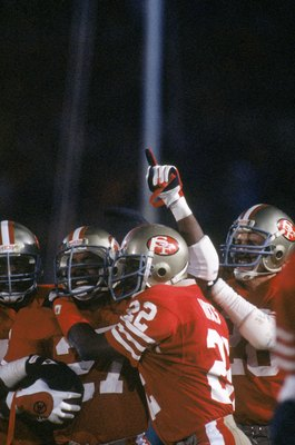 STANFORD, CA - JANUARY 20:  Defensive back Carlton Williamson #27 of the San Francisco 49ers celebrates his end zone interception with teammate Dwight Hicks #22 during Super Bowl XIX against the Miami Dolphins at Stanford Stadium on January 20, 1985 in St