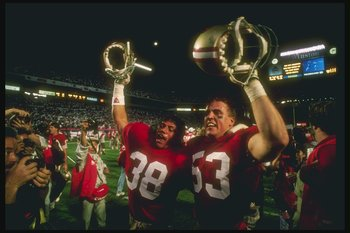 22 Jan 1989: San Francisco 49ers players celebrate during Super Bowl XXIII against the Cincinnati Bengals at Joe Robbie Stadium in Miami, Florida. The 49ers won the game, 20-16.